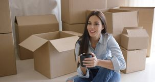 Thoughtful young woman contemplating her new house stock video footage