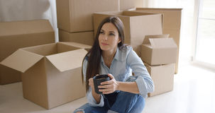 Thoughtful young woman contemplating her new house Royalty Free Stock Photo
