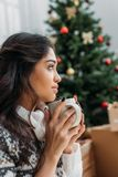 Woman with cup of hot drink on christmas stock photo