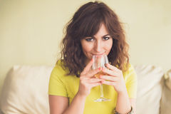 Thoughtful young woman drinking white wine Stock Photography