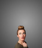 Thoughtful young woman gesturing with copy space Royalty Free Stock Image