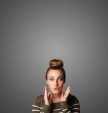 Thoughtful young woman gesturing with copy space Royalty Free Stock Images