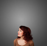 Thoughtful young woman gesturing with copy space Royalty Free Stock Photo