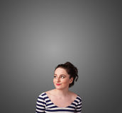 Thoughtful young woman gesturing with copy space Stock Images