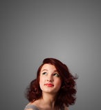 Thoughtful young woman gesturing with copy space Royalty Free Stock Photos