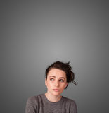 Thoughtful young woman gesturing with copy space Stock Photography