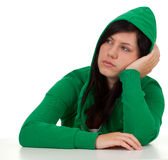 Thoughtful young woman in green sweatshirt Royalty Free Stock Photos