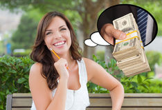 Thoughtful Young Woman with Hand Holding Stack of Money Inside T. Hought Bubble royalty free stock image