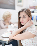Thoughtful young woman having coffee in cafe Stock Photos
