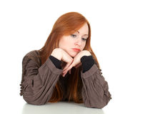 Thoughtful young woman with head on palm Stock Photography