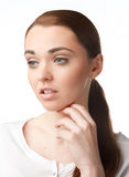 Thoughtful young woman holding hand on chin Royalty Free Stock Images