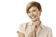 Thoughtful young woman holding pen Royalty Free Stock Photo