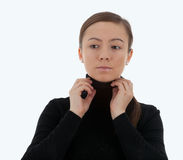 Thoughtful young woman improves blouse Stock Photography