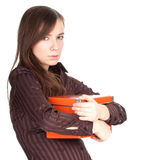 Thoughtful young woman keeping orange box Royalty Free Stock Photography