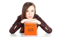 Thoughtful young woman keeping orange box Stock Image