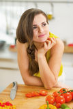 Thoughtful young woman in kitchen Royalty Free Stock Photo