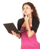 Thoughtful young woman with laptop Royalty Free Stock Photo