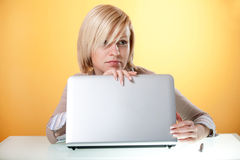 Thoughtful young woman with a laptop Royalty Free Stock Photo
