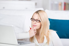 Thoughtful Young Woman With Laptop Stock Images