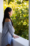 Thoughtful young woman leaning on retaining wall in cafe Royalty Free Stock Photography