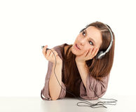 Thoughtful young woman listening to music Royalty Free Stock Photography