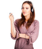 Thoughtful young woman listening to music Stock Photography
