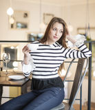 Thoughtful young woman looking away while having coffee at cafe Royalty Free Stock Photography