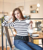 Thoughtful young woman looking away while having coffee at cafe Stock Photography