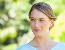 Thoughtful young woman looking away in park Royalty Free Stock Images