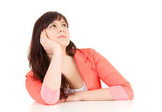 Thoughtful young woman looking up Stock Image
