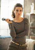 Thoughtful young woman with microphone Royalty Free Stock Photo