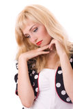 Thoughtful young woman in Polka dot coat. Attractive thoughtful young woman in Polka dot coat Royalty Free Stock Images