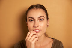 Thoughtful young woman posing for camera Royalty Free Stock Image