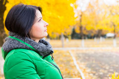 Thoughtful young woman relaxing outdoors Royalty Free Stock Photos