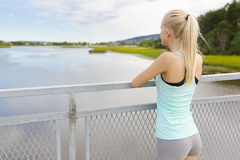 Thoughtful young woman rests after training Royalty Free Stock Photos