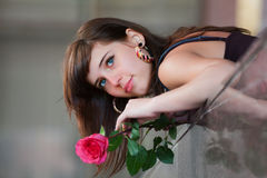 Thoughtful young woman with rose. Stock Photography