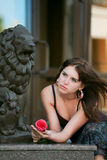 Thoughtful young woman with rose. Royalty Free Stock Images