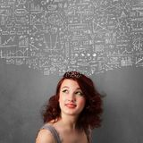 Young woman gesturing with sketched charts above her head Royalty Free Stock Image