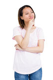 Thoughtful young woman standing with hand on chin Royalty Free Stock Photo