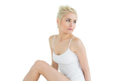 Thoughtful young woman in tank top Royalty Free Stock Image