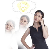Thoughtful young Woman Thinking a big idea Stock Photo