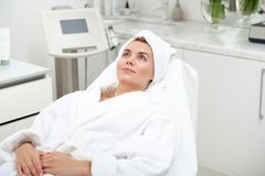 Thoughtful young woman during treatment stock image