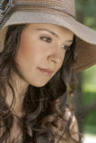 Thoughtful young woman wearing sunhat in park Stock Photography