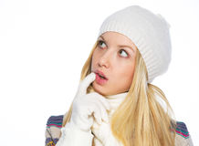 Thoughtful young woman in winter clothes looking on copy space Stock Images