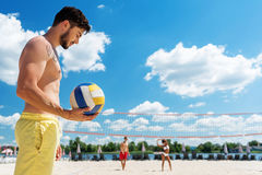 Thoughtful youthful guy with beard resting on summer beach Stock Image