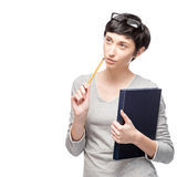 Thoughtfull casual woman holding book and pencil Royalty Free Stock Image