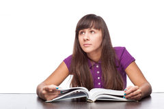 Thoughtfull girl with book Royalty Free Stock Images