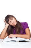 Thoughtfull girl with book Stock Images