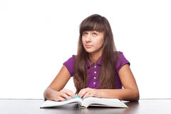 Thoughtfull girl with book Royalty Free Stock Photography