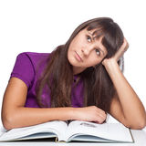 Thoughtfull girl with book Stock Image